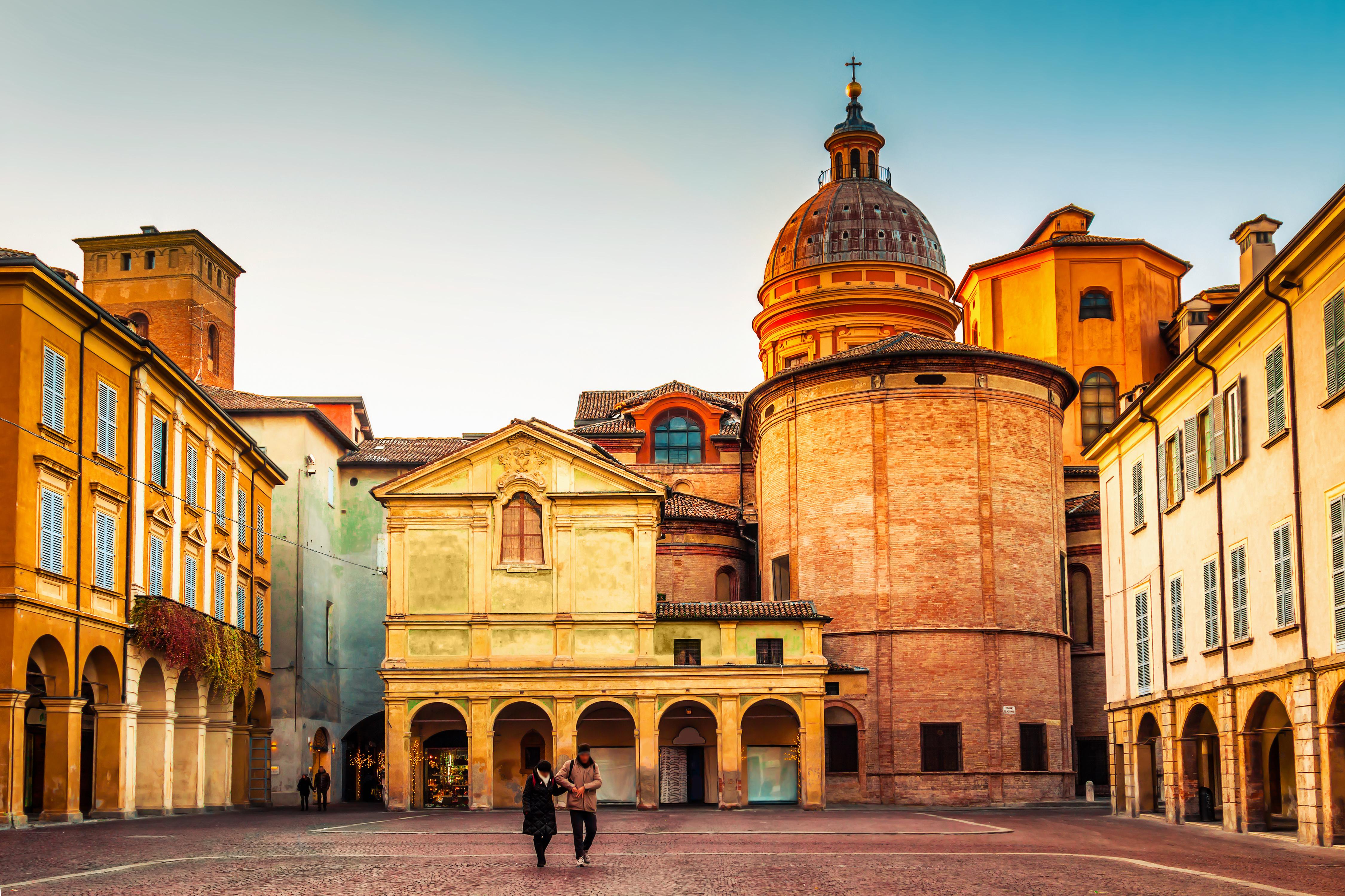 Beautiful architecture at Piazza San Prospero in Reggio Emilia at sunset, Emilia-Romagna region, Italy.